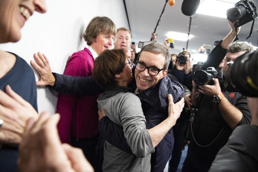Jens Soering, center, arrives at Frankfurt Airport in Germany on Dec. 17, 2019.