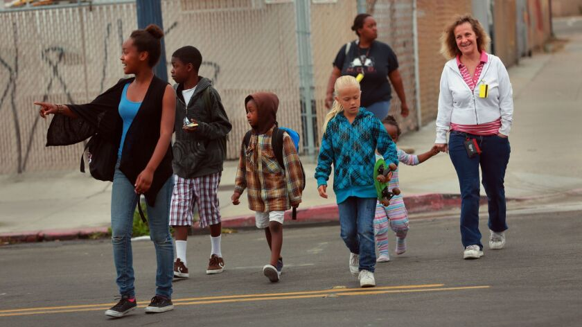 May 22, 2013 San Diego, CA. USA | Students walking across the street en route to the new Monarch