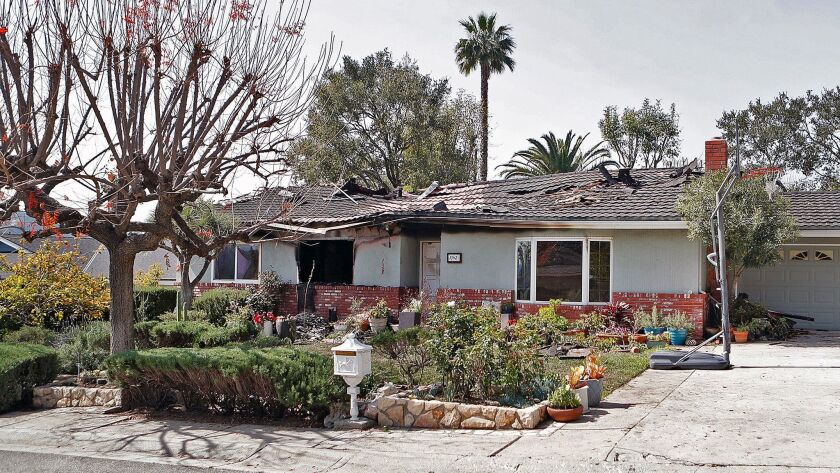 A burned-out home on a private street off of Fairview Avenue in La Canada Flintridge on Friday, Marc