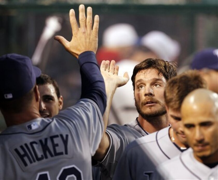 - CORRECTS PLAYER AND INNING - Tampa Bay Rays John Jaso is congratulated after scoring in the fourth inning of a baseball game against the Los Angeles Angels in Anaheim Calif., on Tuesday, June 7, 2011. (AP Photo/Christine Cotter)