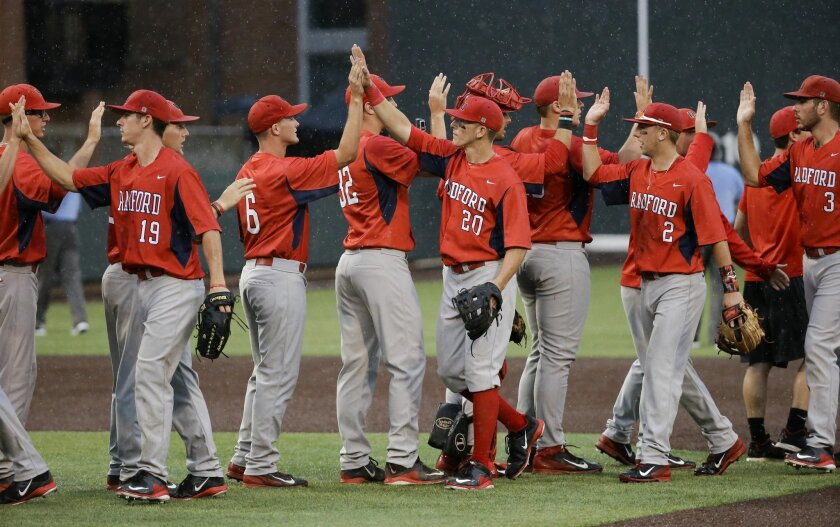 Radford players celebrate after beating Indiana 5-3 in an NCAA college baseball regional tournament game, Sunday, May 31, 2015, in Nashville, Tenn. (AP Photo/Mark Humphrey)