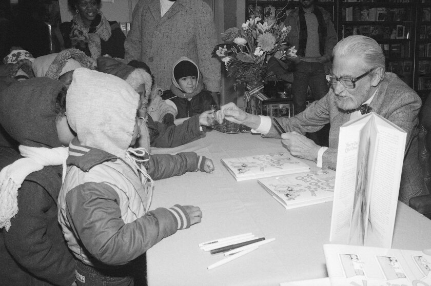 """FILE - In this Feb. 27, 1986, file photo, Theodor Seuss Geisel, known as Dr. Seuss, talks to some children with his  book """"You're Only Old Once!"""" at Barnes and Noble in New York. A Dr. Seuss museum being planned in the author's Massachusetts hometown is expected to fill appetites for the author of"""