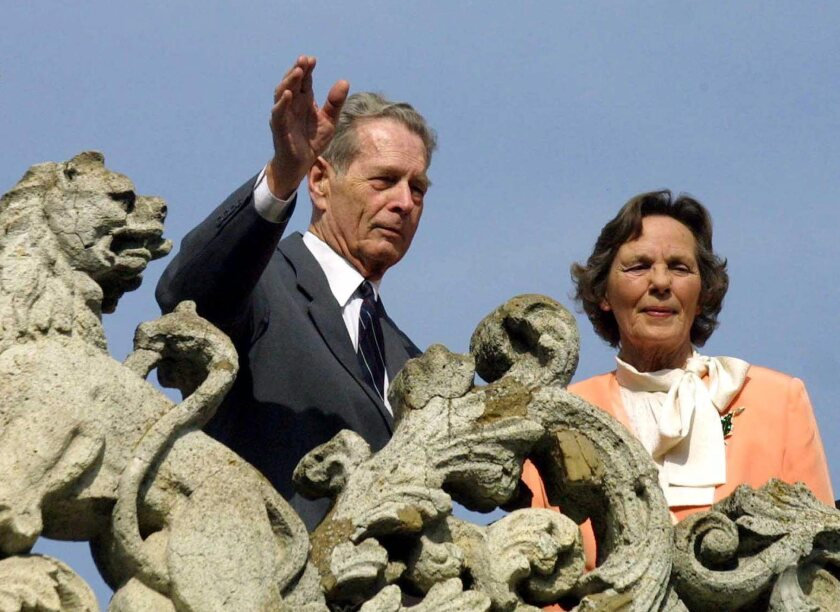 King Michael I of Romania waves to supporters next to his wife Queen Anne of Bourbon-Parma from the balcony of the Elisabeta Palace in Bucharest, Romania, in 2001.