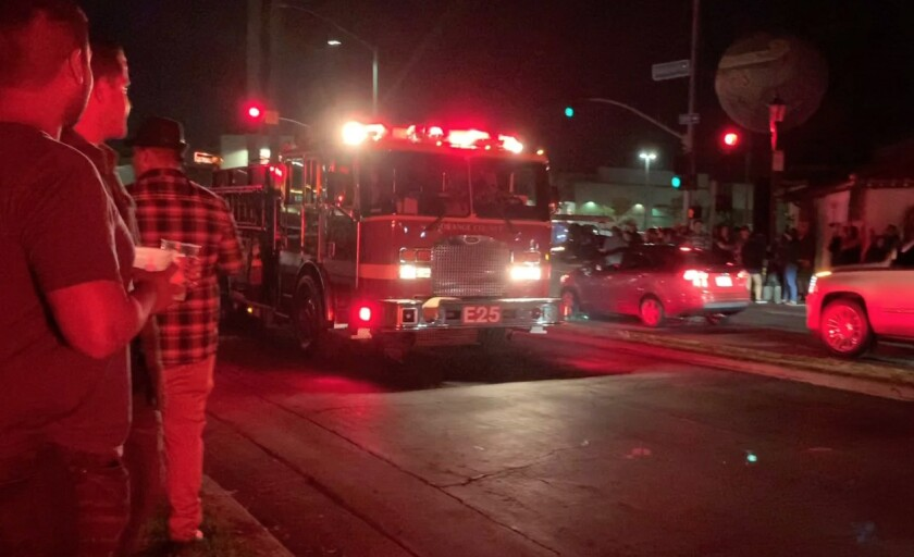 Firefighters respond to reports of an explosion at an Oktoberfest celebration in Huntington Beach on Saturday night.