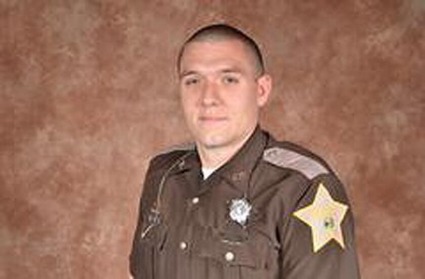 Deputy Carl A. Koontz, 27, of the Howard County Sheriff Department is seen in an undated photo provided by the Indiana State Police. Howard County Sheriff Steven Rogers says Deputy Koontz died at an Indianapolis hospital after being shot about 12:30 a.m. Sunday at a mobile home in Russiaville, about 60 miles north of Indianapolis. Indiana State Police say a second deputy, Sgt. Jordan Buckley, also was shot and is in stable condition, alert and conscious. The suspected shooter, who has not been identified, died. (AP Photo/Indiana State Police)