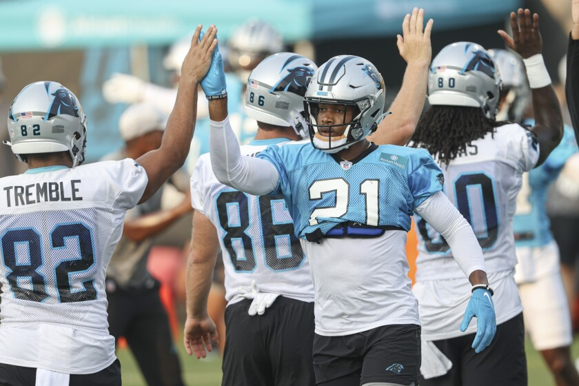 Carolina Panthers linebacker Jeremy Chinn (21) high-fives tight end Tommy Tremble (82) during practice at Back Together Saturday at the NFL football team's training camp in Spartanburg, S.C., Saturday, July 31, 2021. (AP Photo/Nell Redmond)