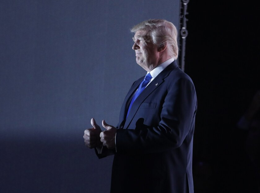 Republican Presidential Candidate Donald Trump walks to the stage during first day of the Republican National Convention in Cleveland, Monday, July 18, 2016.