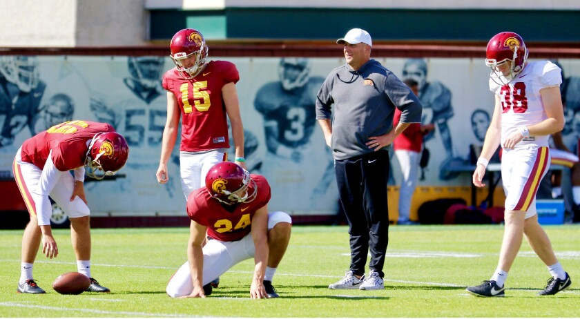 USC coach Clay Helton watches kickers Michael Brown (49), Thomas Fitts (15) and Alex Stadthaus (38)