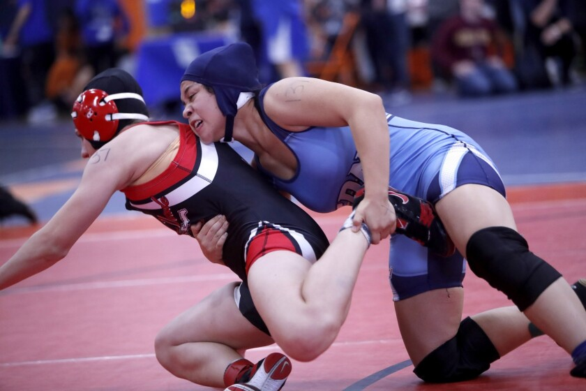 Corona Del Mar High School girls wrestling team member Kiersten Muse, right, battles Rancho Verde Hi