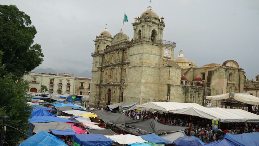 Protesting teachers have thrown up tents and canopies at the zocalo, or central plaza, in Oaxaca city, surrounding the Cathedral with plastic tents and tarps.