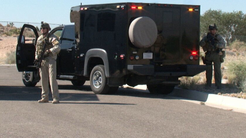Security officers protect big rigs hauling nuclear weapons.