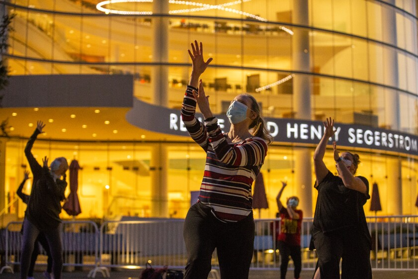 Jeanne Franco, center, and other participants work on choreography at the Segerstrom Center for the Arts.