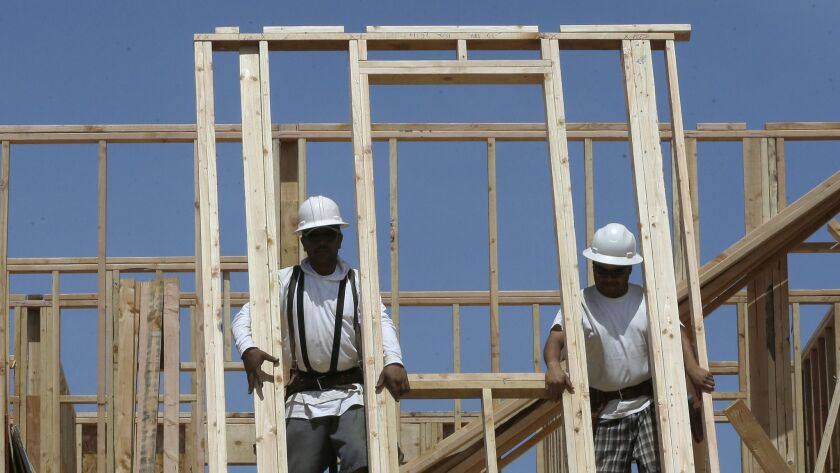 The construction industry gained the most jobs in April of any industry sector in California. Here, a house is under construction near Roseville, Calif.