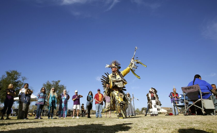 "Sam Bearpaw dances to the traditional Native American drum Saturday. Representatives of several tribes preformed a rain dance on Saturday to attack the drought from a ""spiritual perspective."""