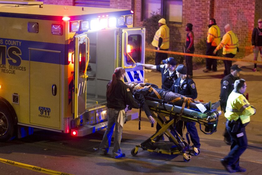 A man is transported to an ambulance after being struck by a vehicle on Red River Street in downtown Austin, Texas, during SXSW on Wednesday March 12, 2014. Police say two people were confirmed dead at the scene after a car drove through temporary barricades set up for the South By Southwest festiv