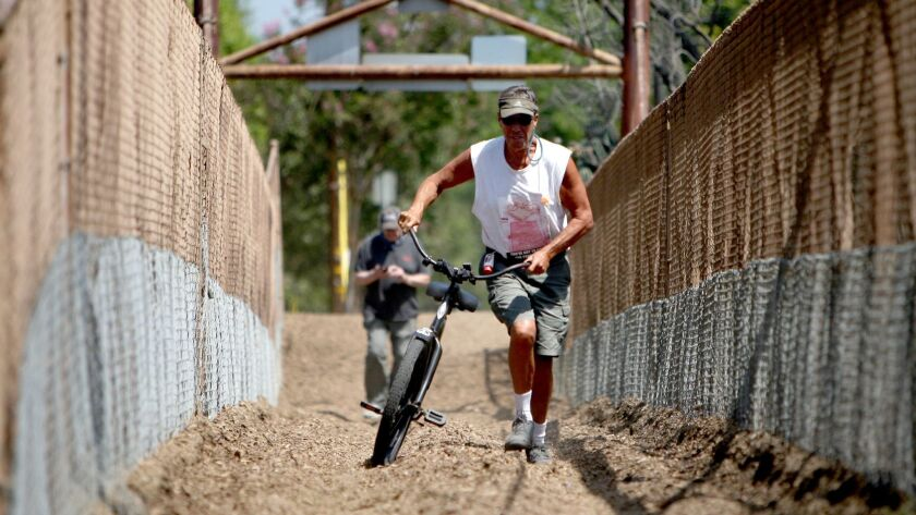 Burbank resident and cycling enthusiast Doug Weiskopf is opposed to the prohibition of walking bicycles across Mariposa Street bridge, which spans the L.A. River from Burbank to Griffith Park.