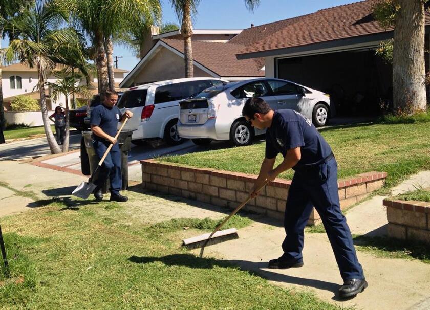 Corona firefighters yard work