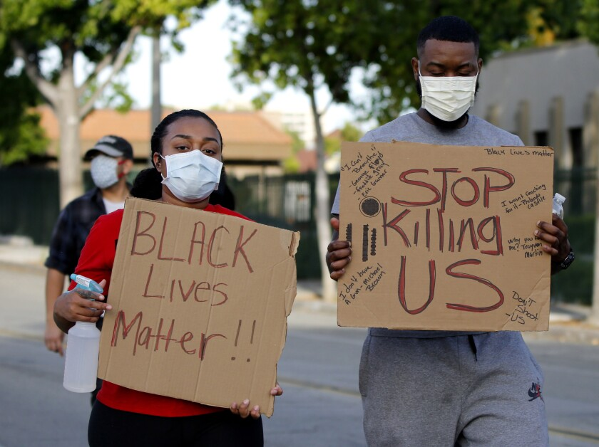 Protesters march through Whittier
