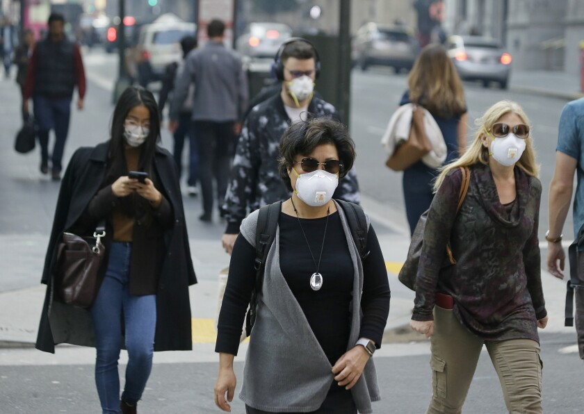 Pedestrians wearing face masks