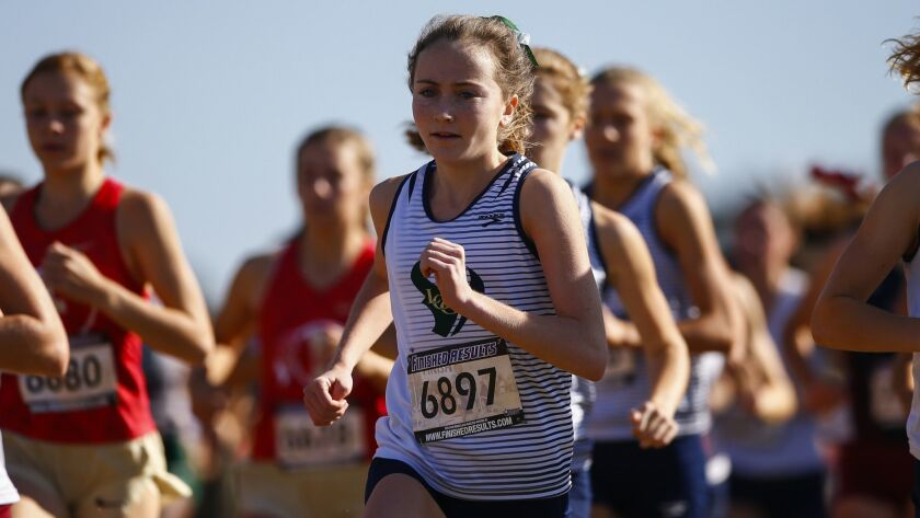 La Costa Canyon's Kristin Fahy runs with the pack at the start of the girl's Division 2 race.