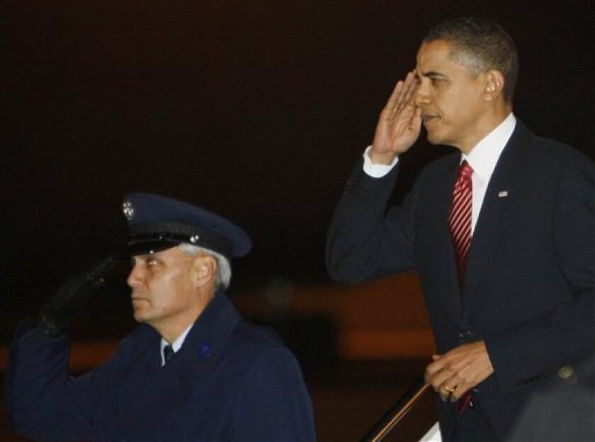 President Barack Obama arrives at Stewart Air Force Base in Newburgh, N.Y., before heading to the United States Military Academy at West Point, N.Y., Tuesday, Dec. 1, 2009, to speak about the war in Afghanistan. (AP Photo/Charles Dharapak)