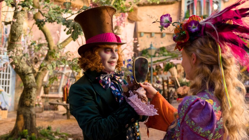 """Alice (Mia Wasikowska) returns to the whimsical world of Underland and travels back in time to save the Mad Hatter (Johnny Depp) in """"Alice Through the Looking Glass."""""""