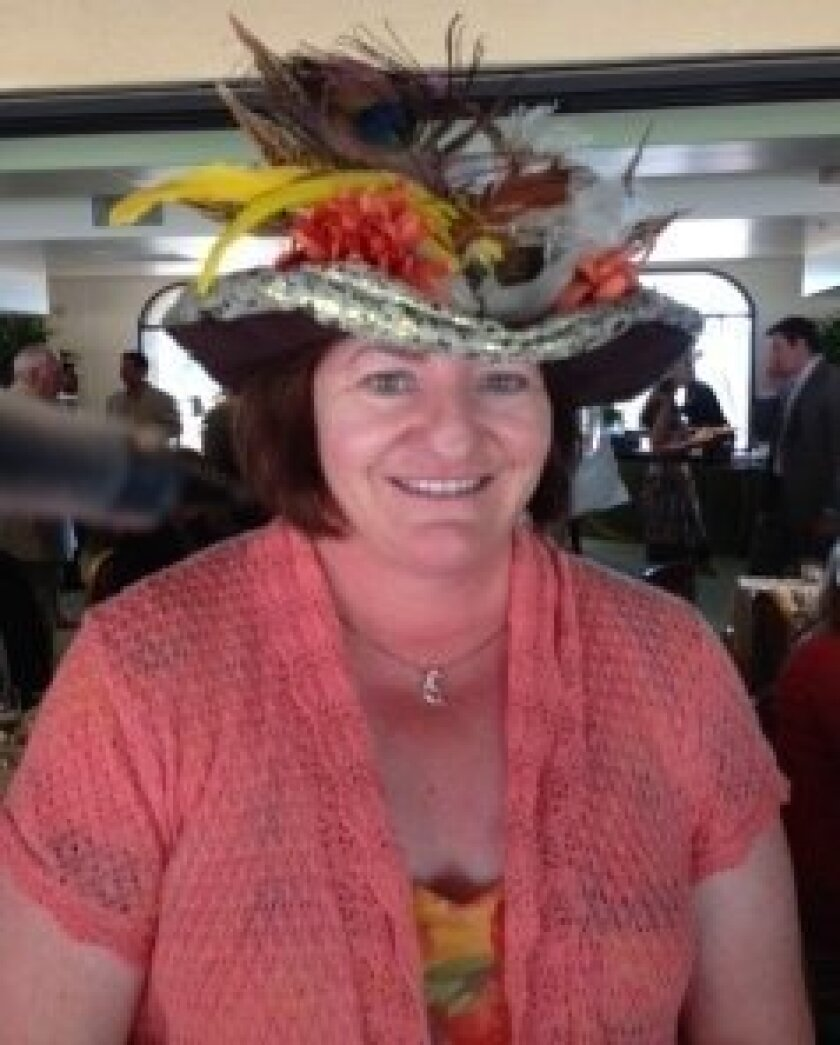 Assembly Majority leader Toni Atkins, of San Diego, sports a hat on Del Mar's Opening Day that she bought for $5 from a charitable group.