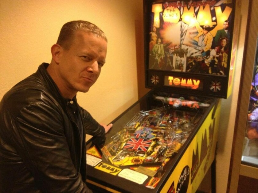 Christian Hoff with Tommy pinball machine.jpg