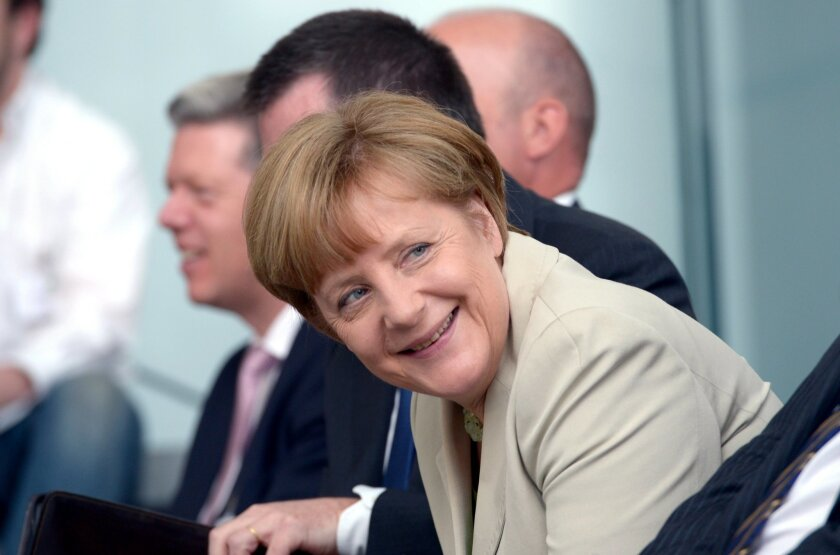 """German Chancellor Angela Merkel smiles during the award ceremony of """"startsocial Competition"""" at the federal chancellery in Berlin, Germany, Tuesday, June 3, 2014. Seven projects were awarded monetary prizes of 35,000 euros in total for their commitment to civil society. (AP Photo/dpa,Rainer Jensen)"""