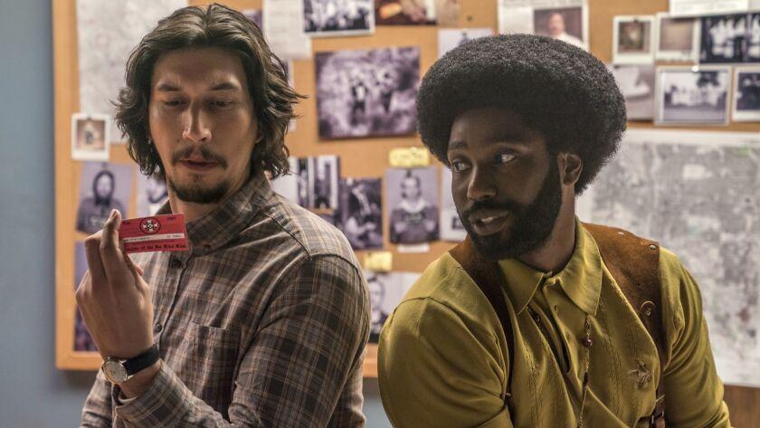 "Adam Driver as Flip Zimmerman and John David Washington as Ron Stallworth in Spike Lee's ""BlacKkKLansman."""
