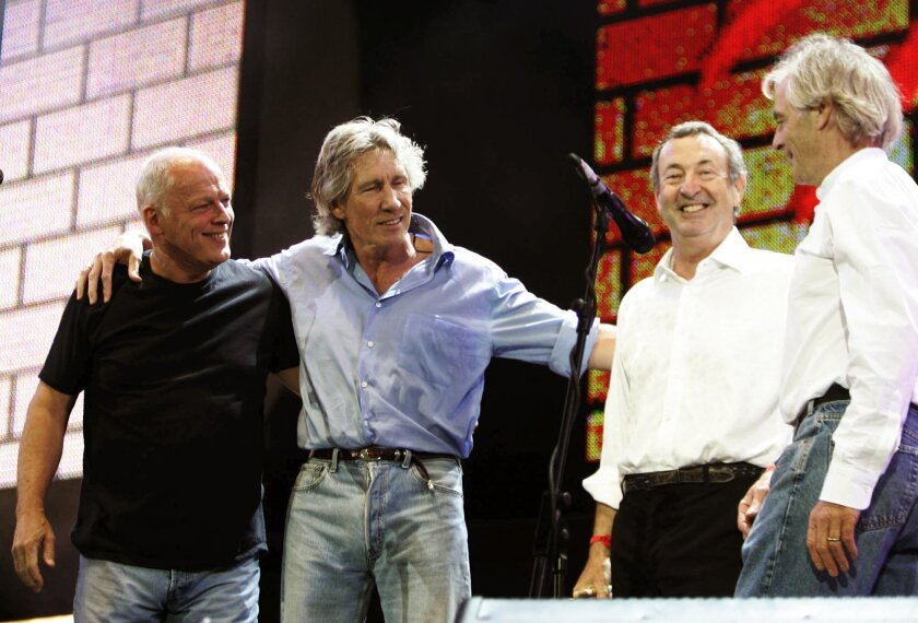 FILE -In this July 2, 2005 file photo, Pink Floyd's Dave Gilmore, left, Roger Waters, second left, Nick Mason, second right, and Rick Wright, appear on stage at the end of their set at the Live 8 concert in Hyde Park, London. The band reunited for a global audience performing a four-song set. Waters left the band in 1985 and Wright passed away in 2008. (AP Photo/Lefteris Pitarakis, File)