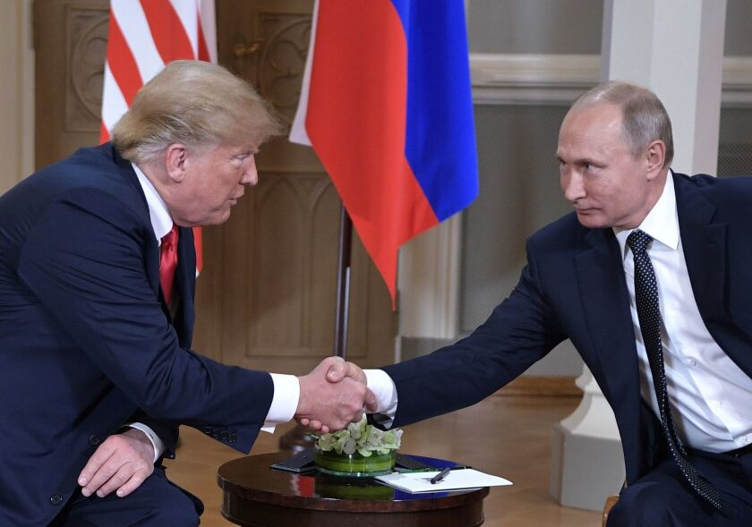 President Trump and Russian President Vladimir Putin shake hands during their one-to-one meeting at the Presidential Palace in Helsinki, Finland, last year.