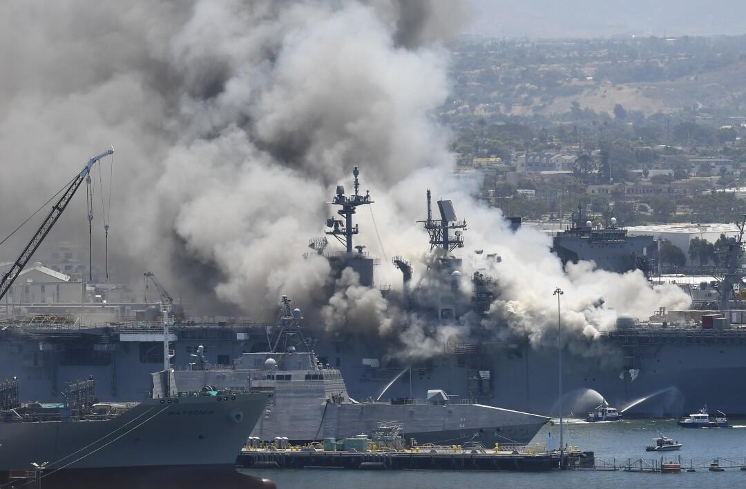 Smoke rises from the USS Bonhomme Richard at Naval Base San Diego Sunday, July 12, 2020.