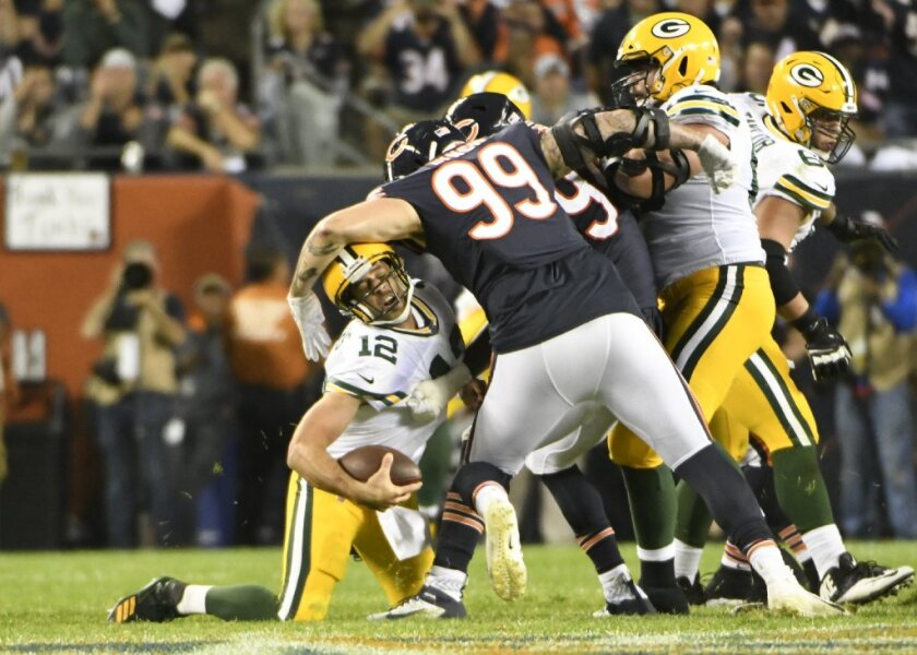 Aaron Rodgers is hit by the Bears' Aaron Lynch Thursday during Green Bay's win, a game with TV ratings up about 15 percent from 2018's Thursday season opener.