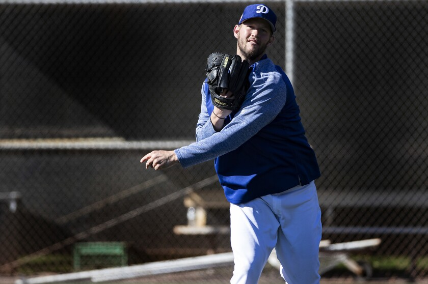 GLENDALE, AZ - FEBRUARY 19, 2019: Dodgers pitcher Clayton Kershaw plays catch during spring trainin