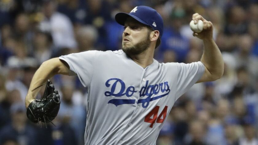 Los Angeles Dodgers' Rich Hill throws during the eighth inning of Game 6 of the National League Cham