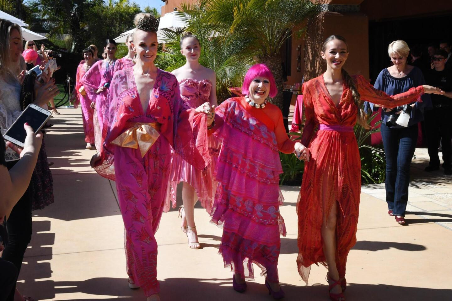 Dame Zandra Rhodes and fashion show models after the show