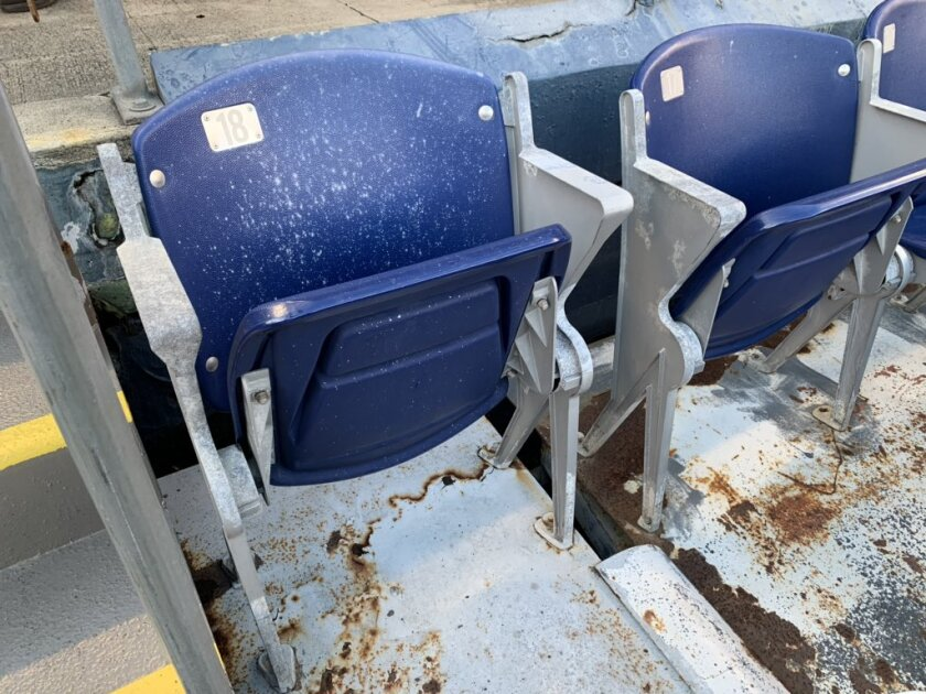 Rusted seats at SDCCU Stadium in San Diego await the upcoming demolition.