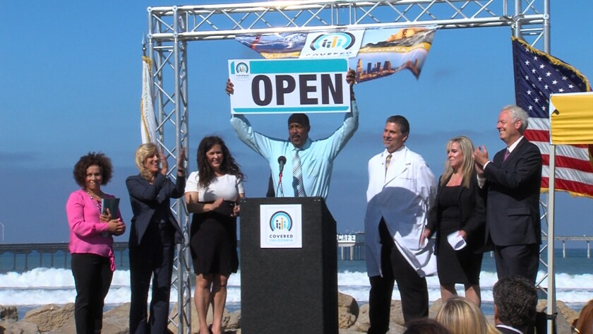 Covered California board member Robert Ross (center) declared the start of Covered California's first open-enrollment period during a launch event at Ocean Beach in 2013.