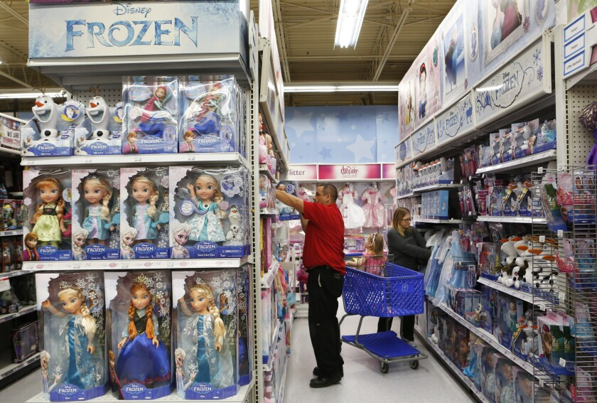 """Shelves are stocked with Frozen merchandise as at this Toys R Us in Los Angeles on February 6, 2015. Sales of merchandise from blockbusters like """"Frozen"""" and the """"Despicable Me"""" series helped drive $107 billion in retail sales for the entertainment-based licensing business last year."""