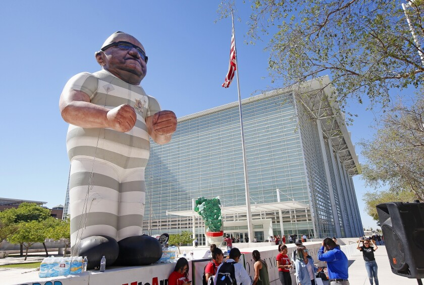 Protesters in Phoenix with an effigy of Maricopa Country Sheriff Joe Arpaio wearing prison clothes.