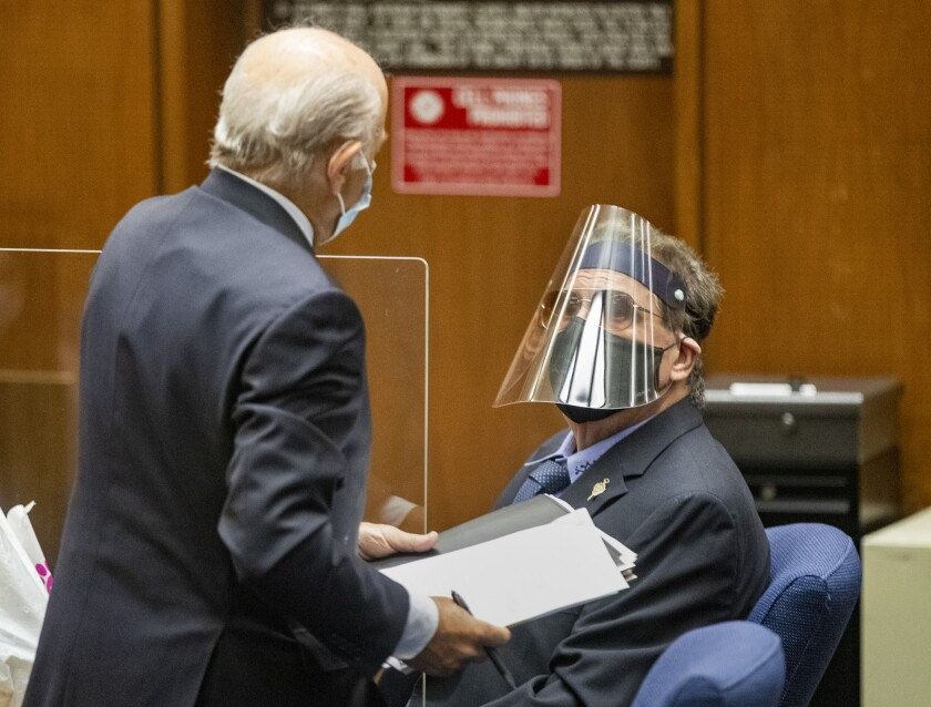 George Tyndall, right, USC's former longtime campus gynecologist, confers with attorney Leonard Levine.