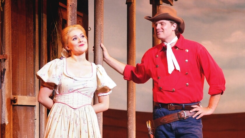 "Callandra Olivia and DanCallaway in a scene from ""Oklahoma!"" at the Cabrillo Music Theater."