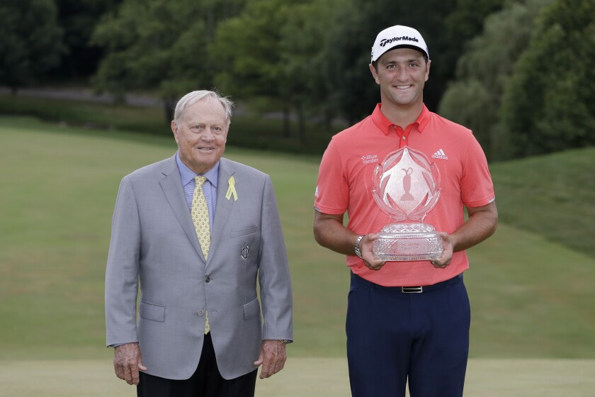 Jon Rahm, of Spain, right, poses with Jack Nicklaus and the trophy after winning the Memorial golf tournament, Sunday, July 19, 2020, in Dublin, Ohio. (AP Photo/Darron Cummings)