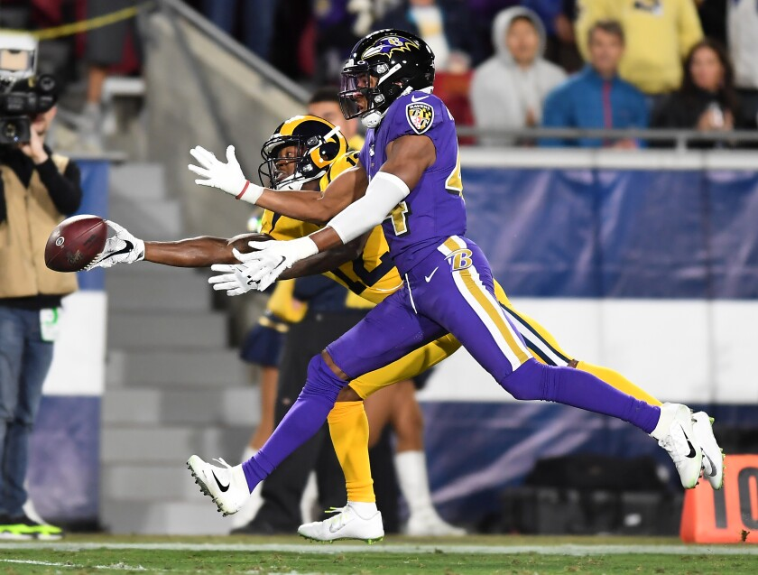 Rams receiver Robert Woods can't make a catch against Baltimore Ravens cornerback Marlon Humphrey.