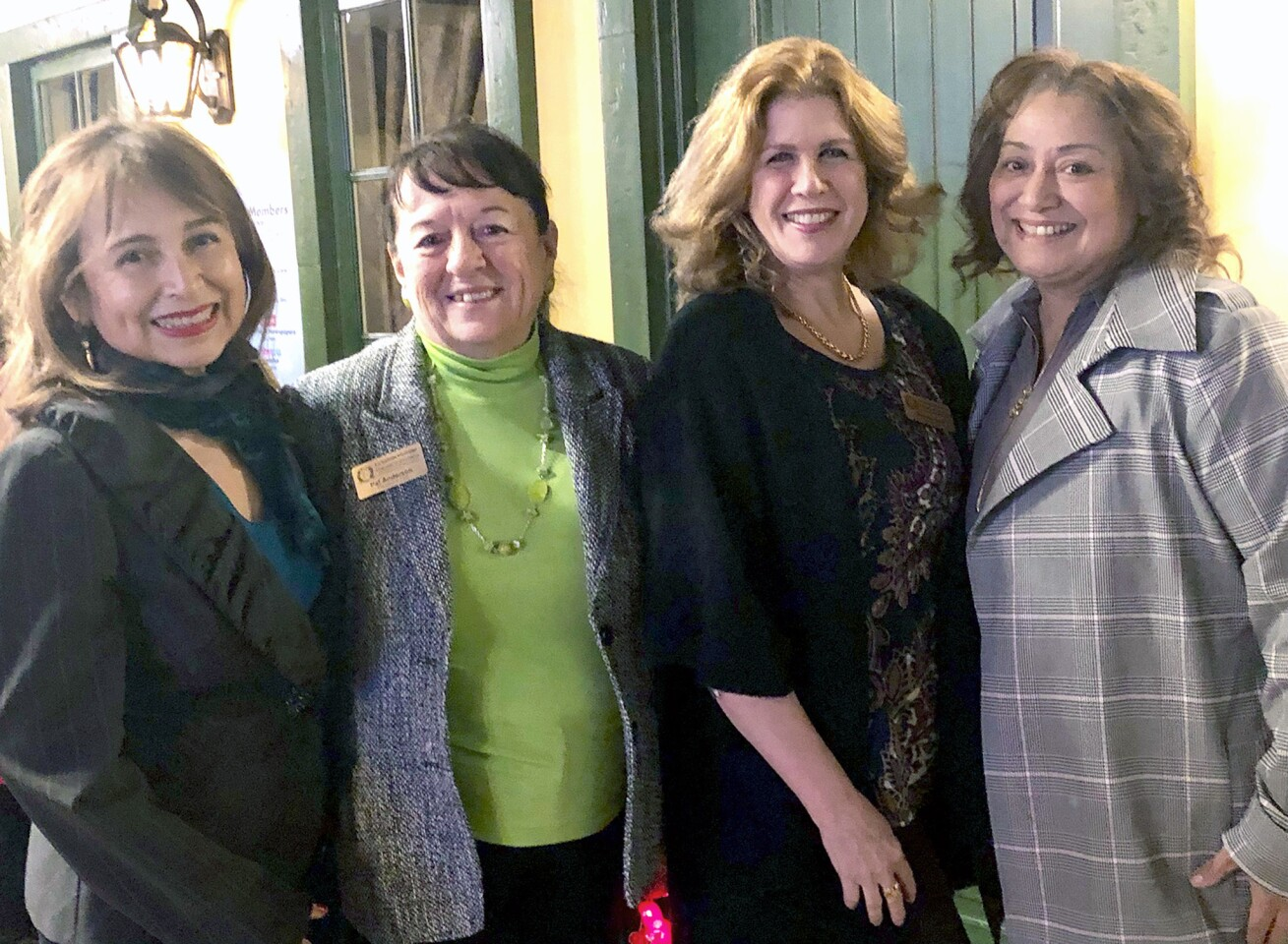 Alice Perez, from left, Pat Anderson, Brenda Gant and Trish McRae catch up on community news during the LCF Chamber mixer at Kobeissi Properties.