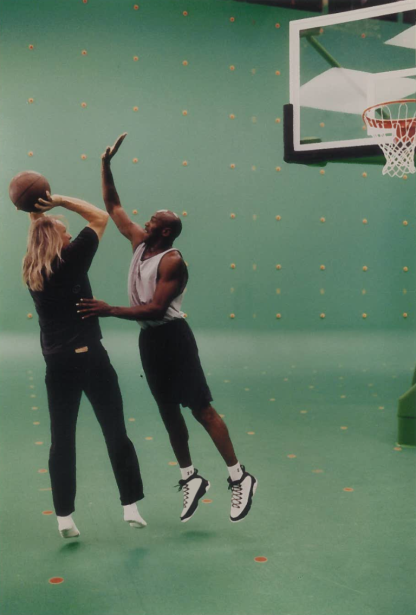 """Space Jam"" director Joe Pytka, left, plays basketball with Michael Jordan on the green-screen set of the animated film, released in 1996."