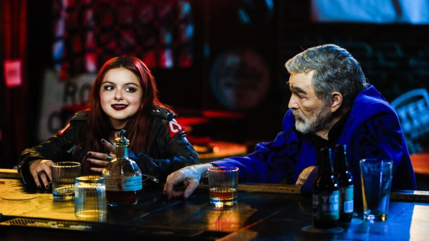 """(L-R) - Lil (Ariel Winter) sits at a bar with Vic Edwards (Burt Reynolds) in a scene from """"The Last"""