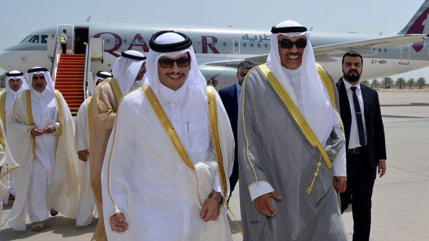 Qatari Foreign Minister Sheik Mohammed bin Abdulrahman al Thani, left, with Kuwaiti counterpart Sheik Sabah al Khaled al Sabah in Kuwait on July 3, 2017.