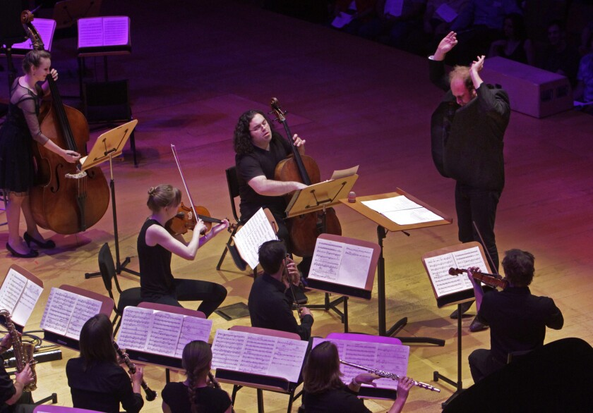 """Conductor Christopher Rountree conducting the group wild Up in composer Julius Eastman's """"Stay On It"""" during the Maximum Minimalism at Walt Disney Concert Hall in LA on Apr. 08, 2014."""